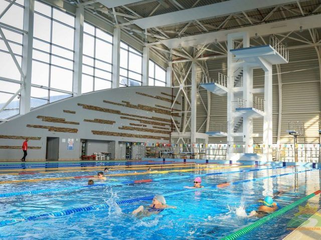 Olympic-sized swimming pool with diving towers