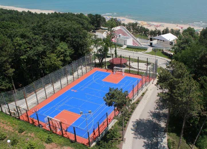 Volleyball and basketball courts, football field with artificial grass